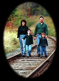 family on railroad tracks